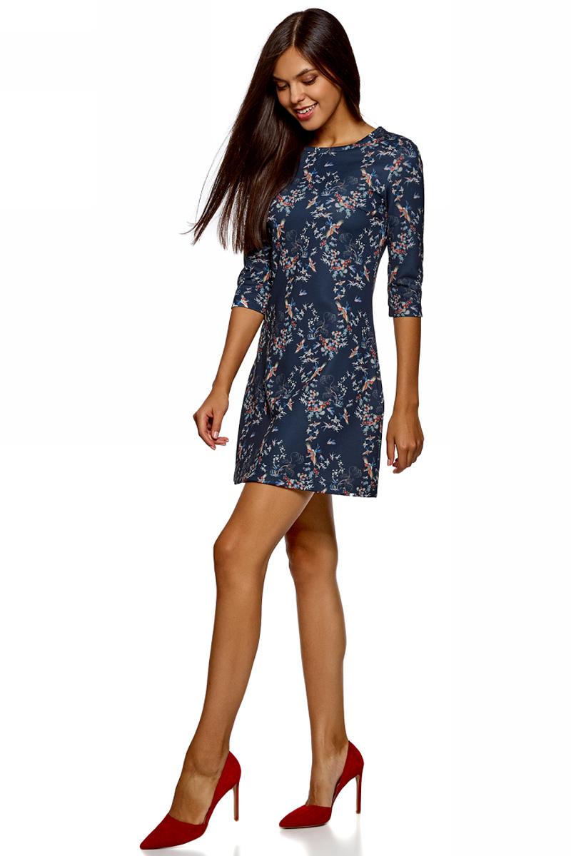 Платье oodji Ultra, цвет: темно-синий. 14000169/33038/7945F. Размер L (48)14000169/33038/7945FСтильное мини-платье от oodji выполнено из эластичного трикотажа. Модель приталенного кроя с рукавами 3/4 и круглым вырезом горловины.