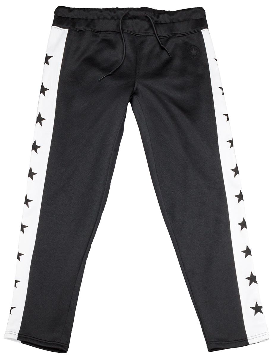 Брюки спортивные женские Converse Star Print CP Pant, цвет: черный. 10004495001. Размер XS (42)10004495001Удобные женские спортивные брюки Converse, выполненные из натурального хлопка с добавлением полиэстера, великолепно подойдут для отдыха, повседневной носки, а также для занятий спортом. Модель на эластичной резинке и шнурке на талии. Такие брюки незаменимая вещь в спортивном и летнем гардеробе. Прекрасный выбор для занятий фитнесом или активного отдыха.