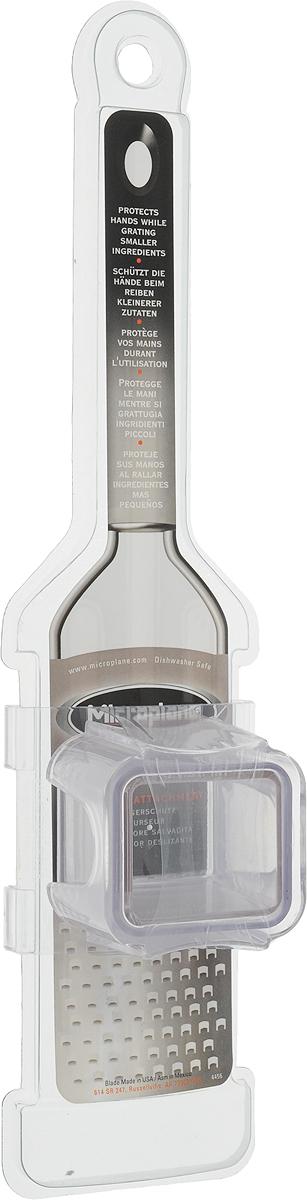 """Насадка-слайдер """"Microplane"""" выполнена из пластика и предназначена для защиты  рук при натирании мелких продуктов - чеснока, специй, редиса, орехов и прочего.  Такой уникальный предмет станет незаменимым помощником на вашей кухне  и понравится любой хозяйке.   Можно мыть в посудомоечной машине."""
