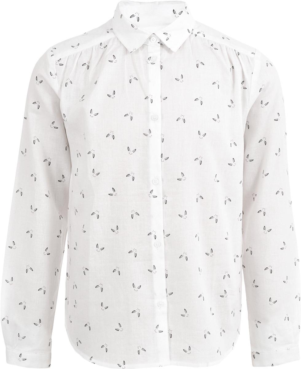 Блузка для девочки Button Blue, цвет: белый. 217BBGC22010207. Размер 122, 7 лет217BBGC22010207Модная блузка для девочки должна выглядеть именно так: свободный прямой силуэт, удлиненная линия спинки, мягкая, приятная на ощупь хлопковая ткань в мелкий равномерный рисунок. Ваша задача купить блузку недорого увенчается успехом, если вы обратите внимание на прекрасную блузку от Button Blue. Дети быстро растут и часто меняют свои вкусовые предпочтения, поэтому всем практичным родителям надо приобретать детские блузки недорого, чтобы обеспечить ребенку должное разнообразие. Белая блузка для девочки сделает образ ребенка стильным и свежим, соответствующим основным трендам сезона Осень/Зима 2017/2018.
