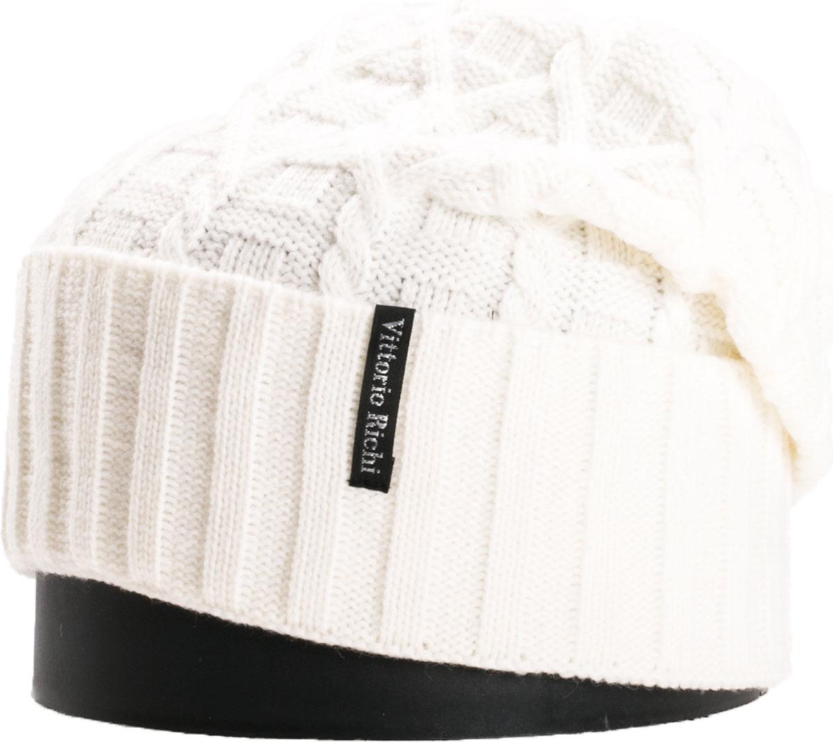 Шапка женская Vittorio Richi, цвет: белый. NSH419022. Размер 56/58NSH419022Стильная женская шапка Vittorio Richi отлично дополнит ваш образ в холодную погоду. Модель, изготовленная из шерсти с добавлением акрила, максимально сохраняет тепло и обеспечивает удобную посадку. Шапка дополнена ажурной вязкой и сбоку фирменной нашивкой. Привлекательная стильная шапка подчеркнет ваш неповторимый стиль и индивидуальность.