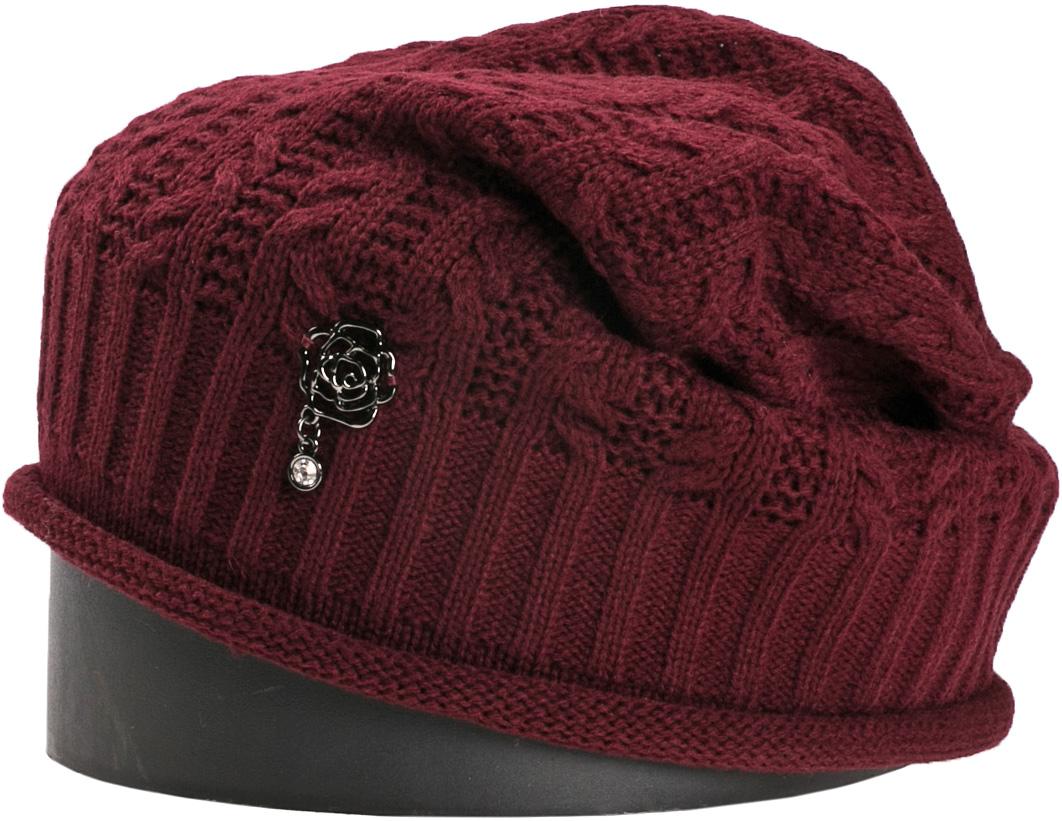 Шапка женская Vittorio Richi, цвет: бордовый. NSH150810. Размер 56/58NSH150810Стильная женская шапка Vittorio Richi отлично дополнит ваш образ в холодную погоду. Модель, изготовленная из шерсти с добавлением акрила, максимально сохраняет тепло и обеспечивает удобную посадку. Шапка дополнена ажурной вязкой и сбоку декоративным элементом. Привлекательная стильная шапка подчеркнет ваш неповторимый стиль и индивидуальность.