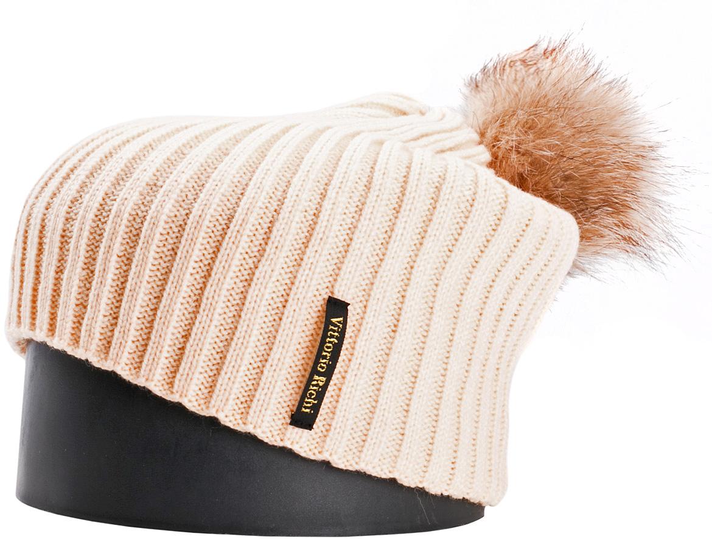 Шапка женская Vittorio Richi, цвет: светлый абрикос. NSH900520. Размер 56/58NSH900520Стильная женская шапка Vittorio Richi отлично дополнит ваш образ в холодную погоду. Модель, изготовленная из шерсти с добавлением акрила, максимально сохраняет тепло и обеспечивает удобную посадку. Шапка дополнена помпоном из меха и сбоку фирменной нашивкой. Привлекательная стильная шапка подчеркнет ваш неповторимый стиль и индивидуальность.