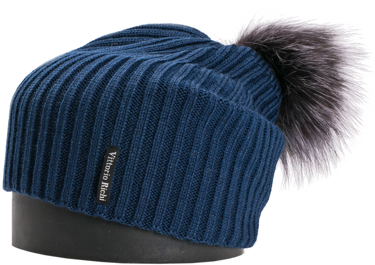 Шапка женская Vittorio Richi, цвет: синий. NSH900517. Размер 56/58NSH900517Стильная женская шапка Vittorio Richi отлично дополнит ваш образ в холодную погоду. Модель, изготовленная из шерсти с добавлением акрила, максимально сохраняет тепло и обеспечивает удобную посадку. Шапка дополнена помпоном из меха и сбоку фирменной нашивкой. Привлекательная стильная шапка подчеркнет ваш неповторимый стиль и индивидуальность.