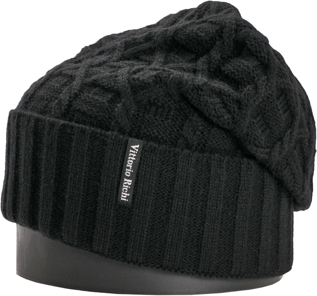 Шапка женская Vittorio Richi, цвет: черный. NSH419001. Размер 56/58NSH419001Стильная женская шапка Vittorio Richi отлично дополнит ваш образ в холодную погоду. Модель, изготовленная из шерсти с добавлением акрила, максимально сохраняет тепло и обеспечивает удобную посадку. Шапка дополнена ажурной вязкой и сбоку фирменной нашивкой. Привлекательная стильная шапка подчеркнет ваш неповторимый стиль и индивидуальность.