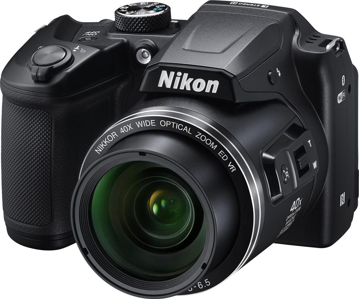 Nikon Coolpix B500, Black цифровая фотокамераVNA951E1Цифровая фотокамера Nikon Coolpix B500 обеспечит легкость получения изображений самого высокого качества.Простота управления и гарантированное получение превосходных результатов позволяют полностью сосредоточиться на творчестве. Часто используемые функции легко доступны с помощью диска выбора режимов, а набор разнообразных функций позволяет без труда создавать впечатляющие видеоролики в формате Full HD (1080p/60i) и великолепные снимки, путешествуя или занимаясь любимым делом, например, созерцанием звездного неба или наблюдением за птицами. Высокоэффективная 16-мегапиксельная КМОП-матрица с обратной подсветкой дает возможность получать такие высококачественные изображения, о которых вы всегда мечтали. Кроме того, вы можете продолжать съемку, куда бы вы ни отправились, ведь фотокамера работает от батарей типоразмера АА, которые можно легко найти в любом уголке мира.Запечатлейте самые интересные моменты спортивных состязаний, фотографируйте отдаленные объекты городских пейзажей с высокой детализацией или делайте четкие снимки звезд и луны в ночном небе, используя объектив NIKKOR с 40-кратным оптическим зумом, который можно расширить до 80-кратного с помощью функции Dynamic Fine Zoom. Надежная оптика NIKKOR гарантирует исключительные результаты, и вы сможете оценить преимущества мощного объектива, охватывающего обширный диапазон углов зрения в компактной фотокамере: от широкоугольного 22,5 мм до супертелефото 900 мм (эквивалент для формата 35 мм).Для получения четких изображений решающее значение имеет устойчивость фотокамеры. Эффективная система подавления вибраций (VR) существенно уменьшает смазывание изображения, вызванное дрожанием фотокамеры, даже при съемке с полным 40-кратным зумом, гарантируя отличную резкость снимков. Воздействие функции подавления вибраций (VR) со смещением линз эквивалентно уменьшению выдержки на 3,0 ступени (на основе стандарта CIPA, в максимальном положении телефото), а удобная рукоятка 