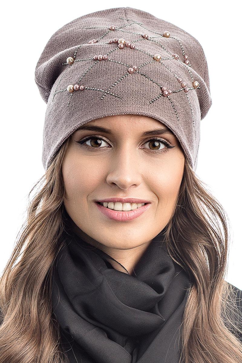 Шапка вязаная женская Stilla, цвет: розовый. SH-1771/16. Размер 52/58SH-1771/16Элегантная вязаная женская шапка Stilla, изготовленная из пряжи с содержанием шерсти и акрила исключительно мягкая, комфортная и теплая. Мелкая плотная вязка, делает эту модель эффектной и не забываемой. Практичная форма шапки делает ее очень комфортной. Трикотажная подкладка отлично защитит в сильный холод. Декорирована бусинами и металлическими стразами.Шапка Stilla прекрасно дополнит ваш образ с шубой или пальто.