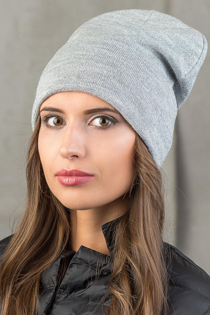 Шапка вязаная женская Stilla, цвет: серый. SH-1767/07. Размер 52/58SH-1767/07Элегантная вязаная женская шапка Stilla, изготовленная из пряжи с содержанием шерсти и акрила исключительно мягкая, комфортная и теплая. Декорированная тонкая нитка люрекса, делает эту модель эффектной и не забываемой. Практичная форма шапки делает ее очень комфортной. Трикотажная подкладка с широким отворотом отлично защитит в сильный холод. Шапка Stilla прекрасно дополнит ваш образ с шубой или пальто.