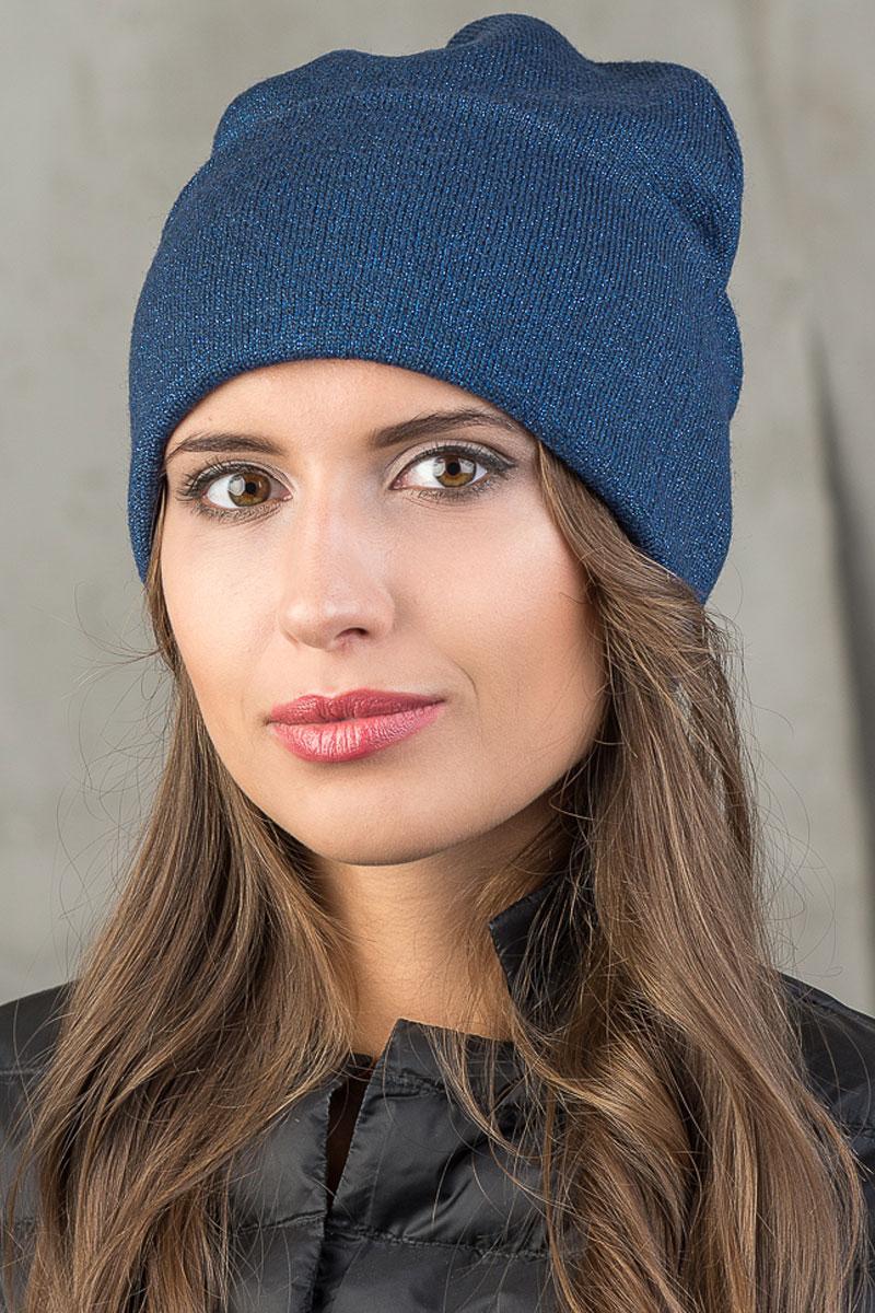 Шапка вязаная женская Stilla, цвет: синий. SH-1767/03. Размер 52/58SH-1767/03Элегантная вязаная женская шапка Stilla, изготовленная из пряжи с содержанием шерсти и акрила исключительно мягкая, комфортная и теплая. Декорированная тонкая нитка люрекса, делает эту модель эффектной и не забываемой. Практичная форма шапки делает ее очень комфортной. Трикотажная подкладка с широким отворотом отлично защитит в сильный холод. Шапка Stilla прекрасно дополнит ваш образ с шубой или пальто.