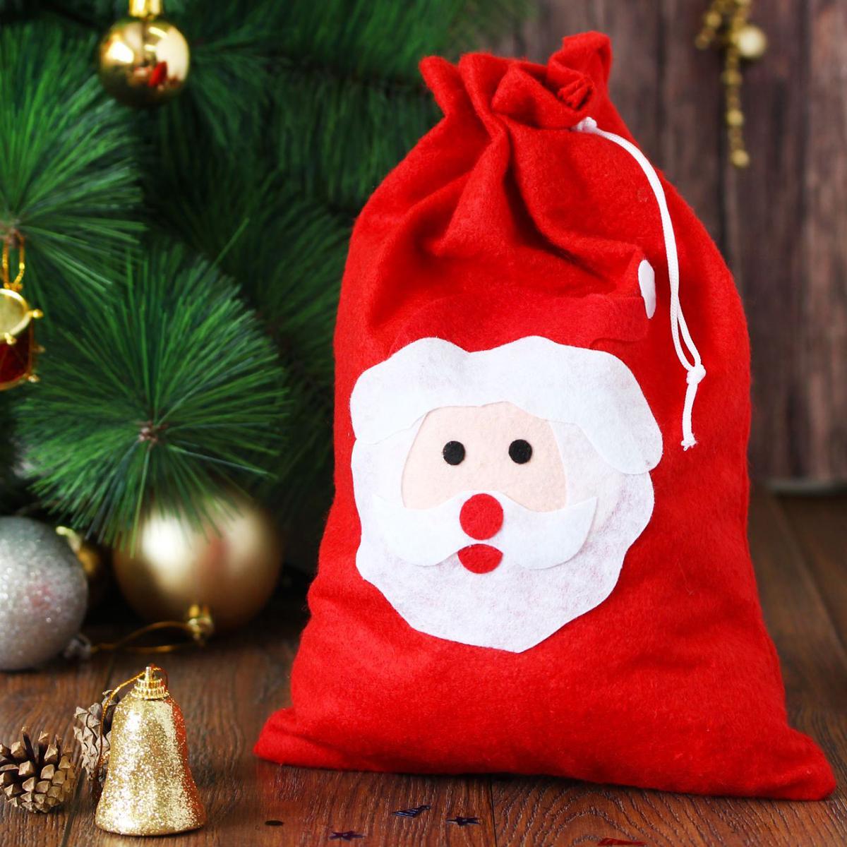 Мешок карнавальный Sima-land Дед Мороз2321636Упаковка – это одна из важных составляющих самого подарка! Дарите ли вы сувениры родственникам, или выбираете подарок для самого близкого человека – правильно подобранная подарочная упаковка усилит радость от самого подарка и поднимет настроение.