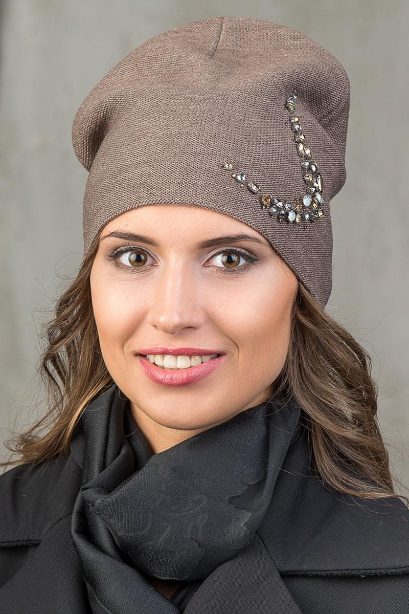 Шапка вязаная женская Stilla, цвет: коричневый. SH-1763/06. Размер 52/58SH-1763/06Элегантная вязаная женская шапка Stilla, изготовленная из пряжи с содержанием шерсти и акрила исключительно мягкая, комфортная и теплая. Мелкая плотная вязка, декорированная украшением из крупных страз делает эту модель эффектной и не забываемой. Практичная форма шапки делает ее очень комфортной. Трикотажная подкладка отлично защитит в сильный холод.Шапка Stilla прекрасно дополнит ваш образ с шубой или пальто.