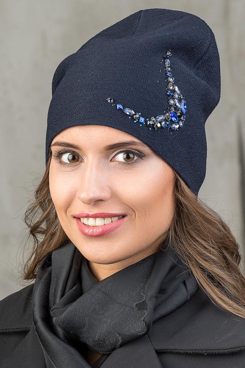 Шапка вязаная женская Stilla, цвет: синий. SH-1763/13. Размер 52/58SH-1763/13Элегантная вязаная женская шапка Stilla, изготовленная из пряжи с содержанием шерсти и акрила исключительно мягкая, комфортная и теплая. Мелкая плотная вязка, декорированная украшением из крупных страз делает эту модель эффектной и не забываемой. Практичная форма шапки делает ее очень комфортной. Трикотажная подкладка отлично защитит в сильный холод.Шапка Stilla прекрасно дополнит ваш образ с шубой или пальто.