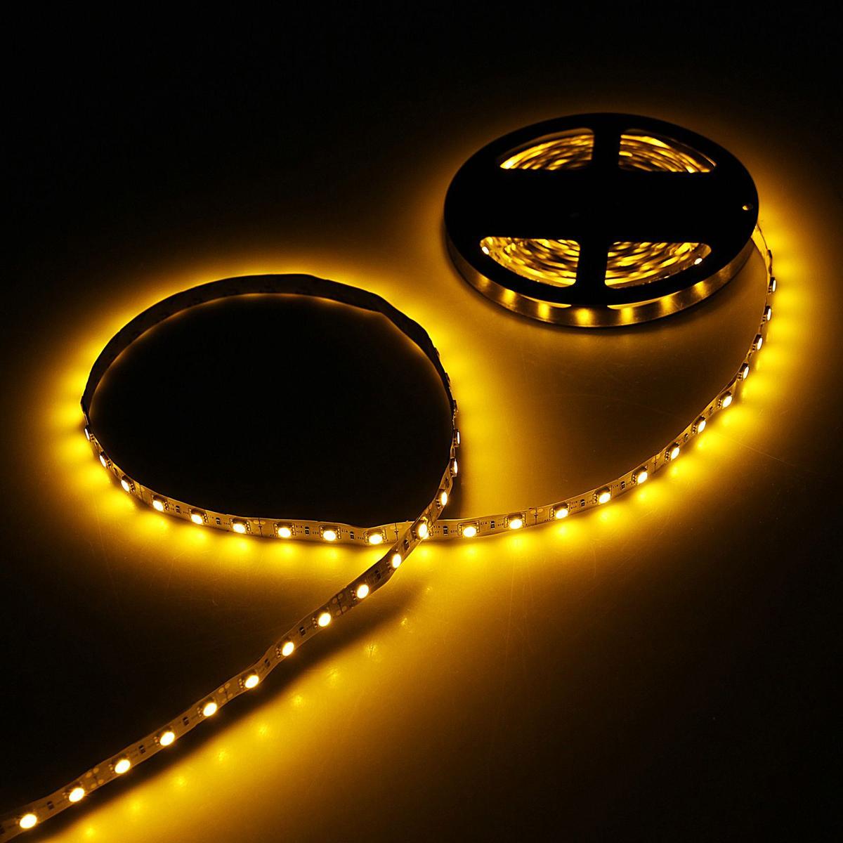 Светодиодная лента Sima-land, 12В, SMD5050, длина 5 м, IP33, 60 LED ламп, 14.4 Вт/м, DC, цвет: желтый682319Светодиодные гирлянды, ленты и т.д — это отличный вариант для новогоднего оформления интерьера или фасада. С их помощью помещение любого размера можно превратить в праздничный зал, а внешние элементы зданий, украшенные ими, мгновенно станут напоминать очертания сказочного дворца. Такие украшения создают ауру предвкушения чуда. Деревья, фасады, витрины, окна и арки будто специально созданы, чтобы вы украсили их светящимися нитями.