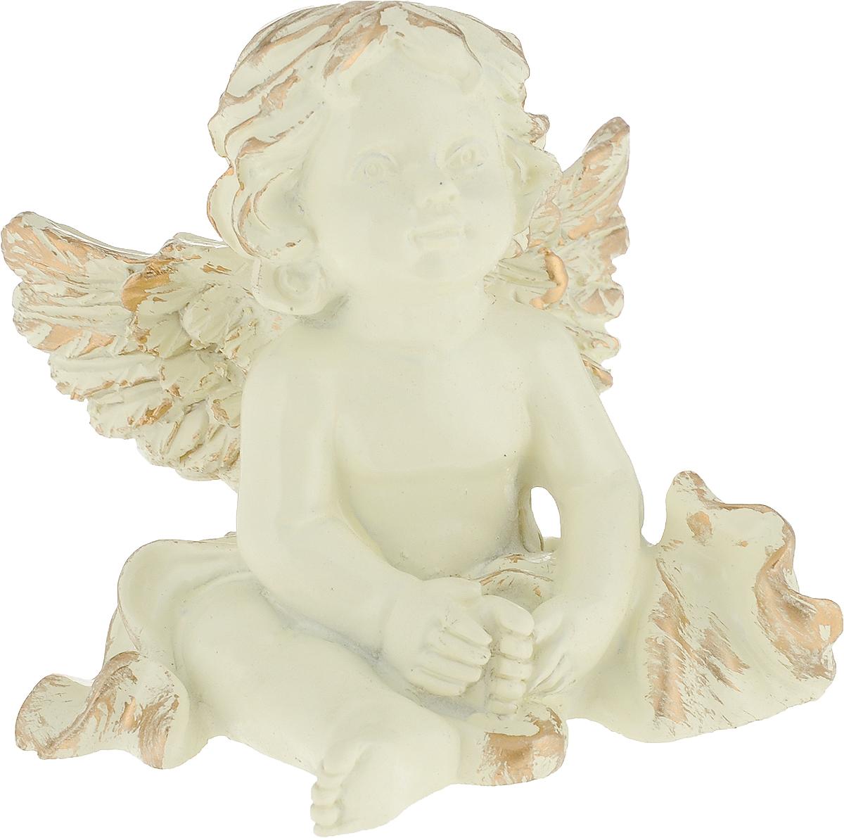 Фигурка декоративная Magic Home Ангелок, цвет: слоновая кость, золотой, 8,2 х 7 х 4,6 см75432Декоративная фигурка Ангелок из полирезина от Magic Home - это это прекрасный вариант подарка для ваших друзей и близких. Оригинальная и стильная фигурка станет отличным дополнением в интерьере любой комнаты и будет удачно смотреться и радовать глаз.