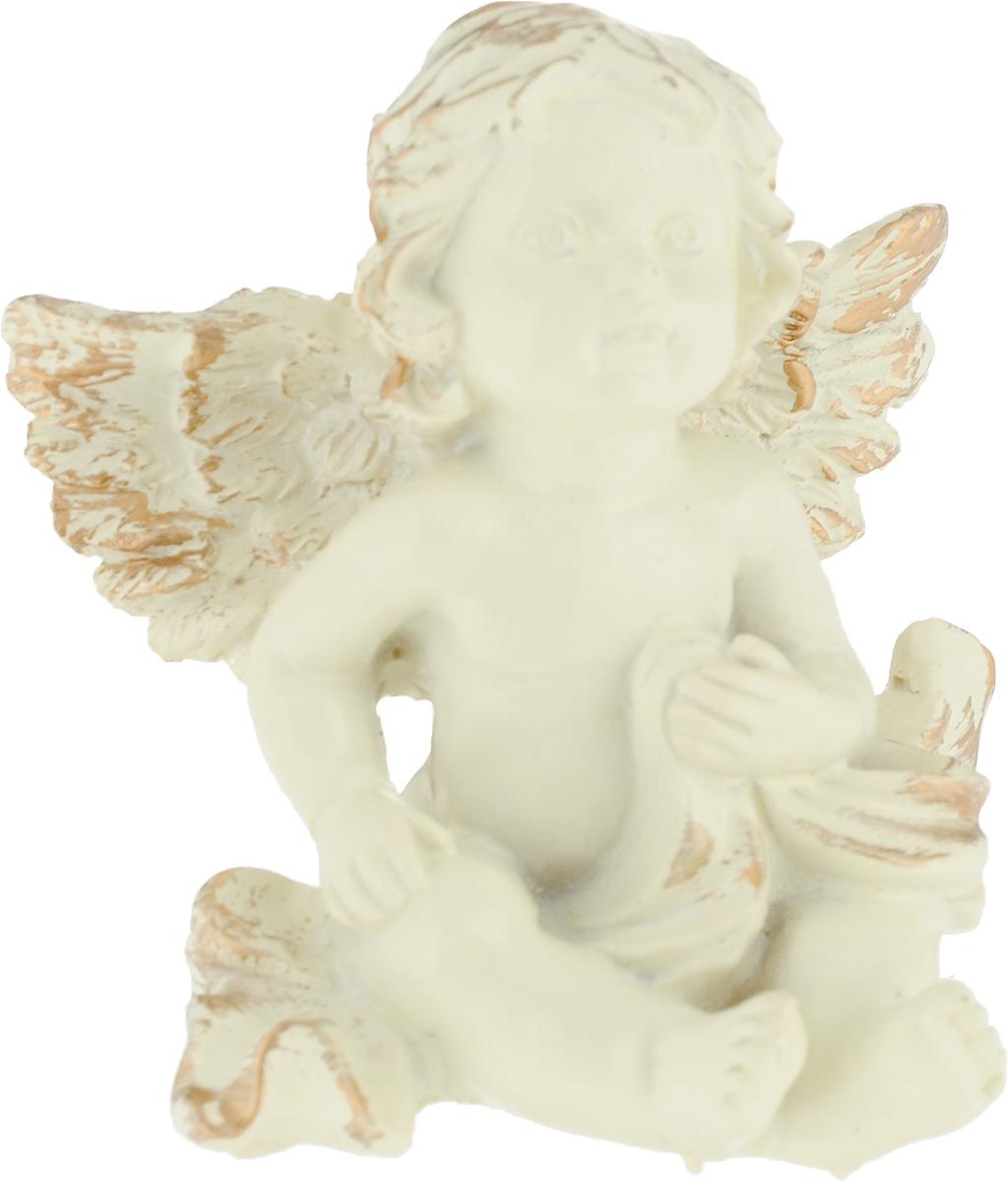Фигурка декоративная Magic Home Мечтательный ангел, цвет: слоновая кость, золотой, 8,2 х 7 х 4,6 см75434Декоративная фигурка Мечтательный ангел из полирезина от Magic Home - это это прекрасный вариант подарка для ваших друзей и близких. Оригинальная и стильная фигурка станет отличным дополнением в интерьере любой комнаты и будет удачно смотреться и радовать глаз.