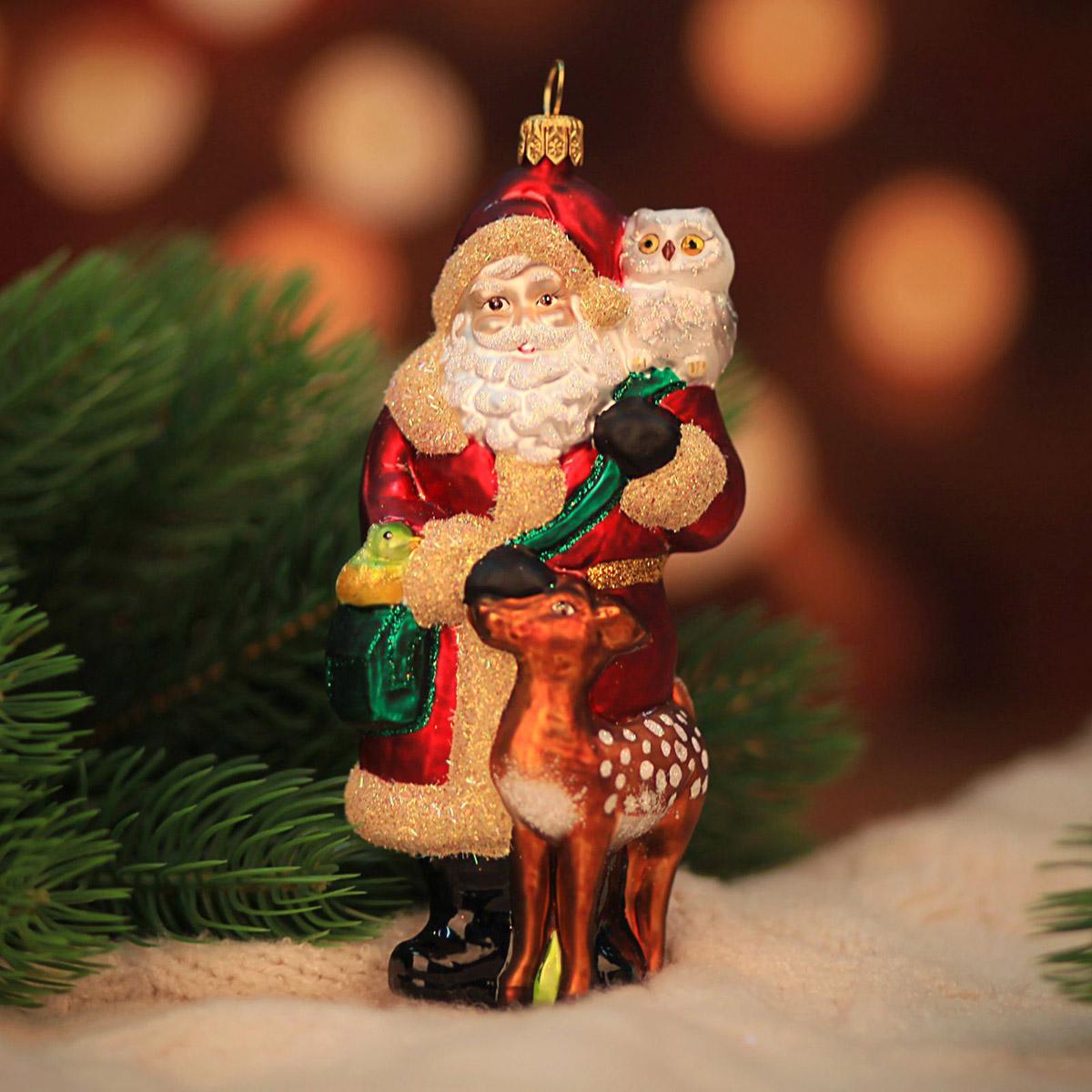 Новогоднее подвесное украшение Hanco Design Лесной санта, высота 14 см106405Новогоднее украшение Hanco Design отлично подойдет для декорации вашего дома и новогодней ели. Елочная игрушка - символ Нового года. Она несет в себе волшебство и красоту праздника. Такое украшение создаст в вашем доме атмосферу праздника, веселья и радости.