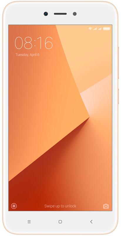 Xiaomi Redmi Note 5A (16GB), GoldREDMINOTE5AGD16GBXiaomi Redmi Note 5A - продолжение популярнейшей линейки мощных и недорогих смартфонов. Он выпускается в полюбившемся многим размере экрана - 5.5 дюйма. Redmi Note опять демонстрирует стремление Xiaomi делать инновации доступными.На большом экране высокой четкости удобно смотреть фильмы, сериалы и играть в ваши любимые игры.При этом его размер удобен для управления одной рукой.Легкий и тонкий. Всего 150 грамм. Напыление, имитирующее металл, позволило сделать корпус легким, а дизайн - футуристическим.Смартфоны с большими экранами могут держать заряд долго. Благодаря емкому аккумулятору (3080 мАч), энергоэффективному процессору и системе оптимизации питания Xiaomi Redmi Note 5A обеспечит до:11 часов просмотра видео;16 часов игры;35 часов активных звонков.Восхитительные селфи. 36 бьюти-фильтров, автоспуск. В Xiaomi это называют - красота в режиме реального времени. Без косметики. Поймайте нужный ракурс, нажмите на кнопку и поделитесь с друзьями!Камера 13 Мп. Невероятное качество снимков. Трудно поверить, что эти фотографии сделаны на камеру смартфона.В Xiaomi Redmi Note 5A вы можете пользовать 2 SIM-картами одновременно с microSD-картой (до 128 ГБ) для хранения фотографий и приложений.Телефон сертифицирован EAC и имеет русифицированный интерфейс меню и Руководство пользователя.