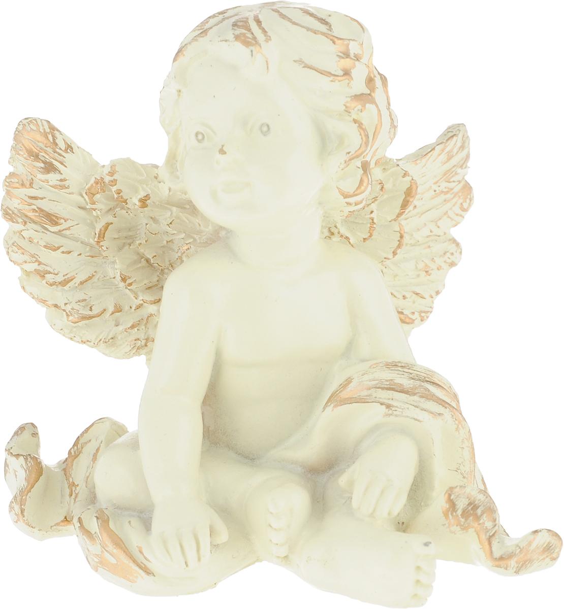 Фигурка декоративная Magic Home Задумчивый ангел, цвет: слоновая кость, золотой, 8,2 х 7 х 4,6 см75433Фигурка декоративная Magic Home Задумчивый ангел - это прекрасный вариант подарка для ваших друзей и близких. Изделие изготовлено из полирезины и выполнено в виде ангела. Оригинальная и стильная фигурка станет отличным дополнением в интерьере любой комнаты и будет удачно смотреться и радовать глаз. Размеры: 6,5 х 7 х 5,5 см.