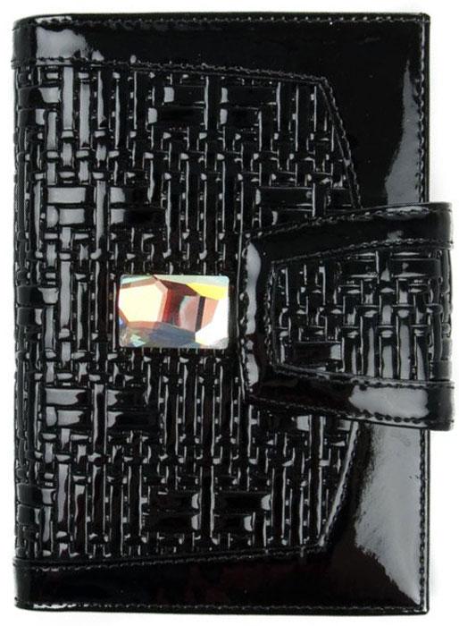 Обложка для автодокументов женская Krystall, цвет: черный. 0-508(СВ)0-508(СВ)Обложка для автодокументов Krystall декорирована оригинальными кристаллами Swarovski. Внутри изделия пластиковый вкладыш для документов, текстильная подкладка, отдел для купюр, четыре кармашка для кредитных карт. С обеих сторон по две накладки из кожи. Закрывается на магнитную застежку.Обложка для автодокументов станет отличным приобретением для себя или подарком для подруги.