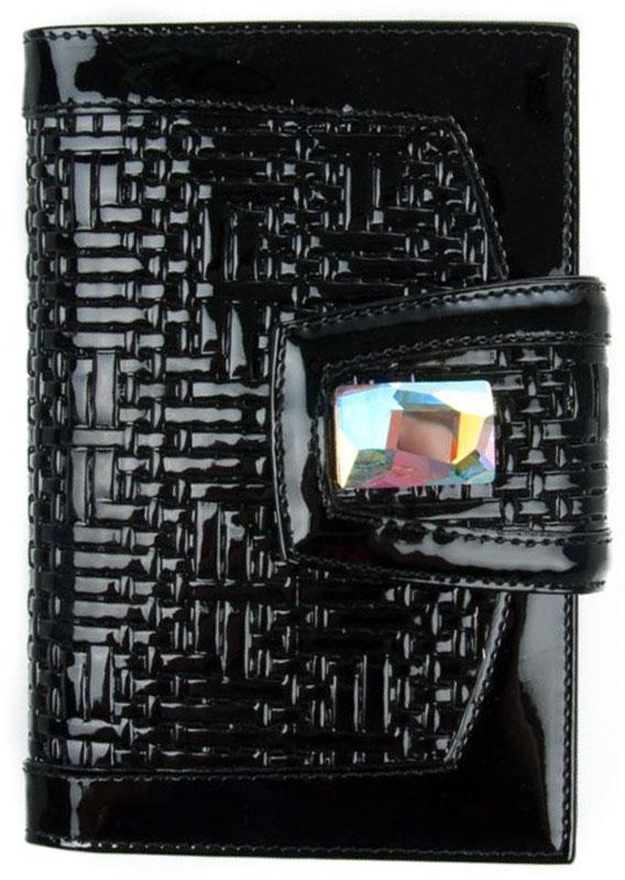 Обложка для паспорта женская Krystall, цвет: черный. 0-509(СВ)0-509(СВ)Обложка для паспорта Krystall декорирована оригинальными кристаллами Swarovski. Внутри текстильная подкладка, два пластиковых и четыре из кожи боковые держатели. Закрывается на кнопку.Обложка для паспорта Krystall придется по вкусу любой женщине, следящей за модой.