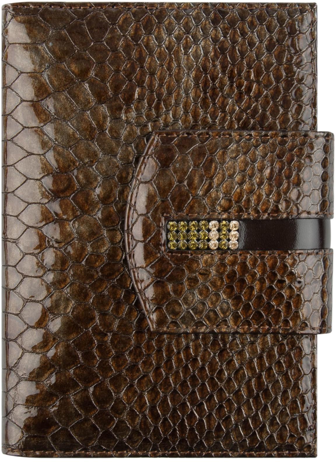 Обложка для автодокументов женская Krystall, цвет: коричневый. 0-490(СВ)Натуральная кожаОригинальные кристаллы Swarovski. Внутри изделия имеется съемный пластиковый вкладыш для авто-документов. С одной стороны 4 кожаных кармана для кредитных карт, а с другой - один дополнительный карман. Само изделие закрывается клапаном на кнопке.