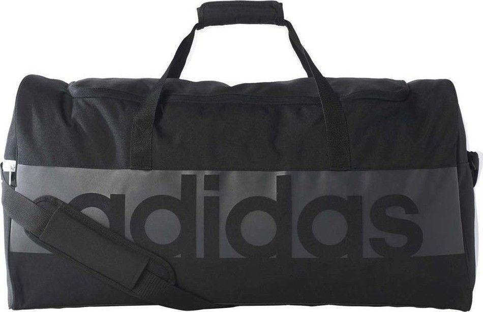 Сумка спортивная Adidas Tiro Lin TB L, цвет: черный. B46119B46119Удобная спортивная сумка футбольной коллекции всемирноизвестного спортивного бренда Adidas. Идеальна для тренировок на поле и занятий в зале. Имеет большое отделение и закрывется на молнию. Дополнена плечевым ремнем.