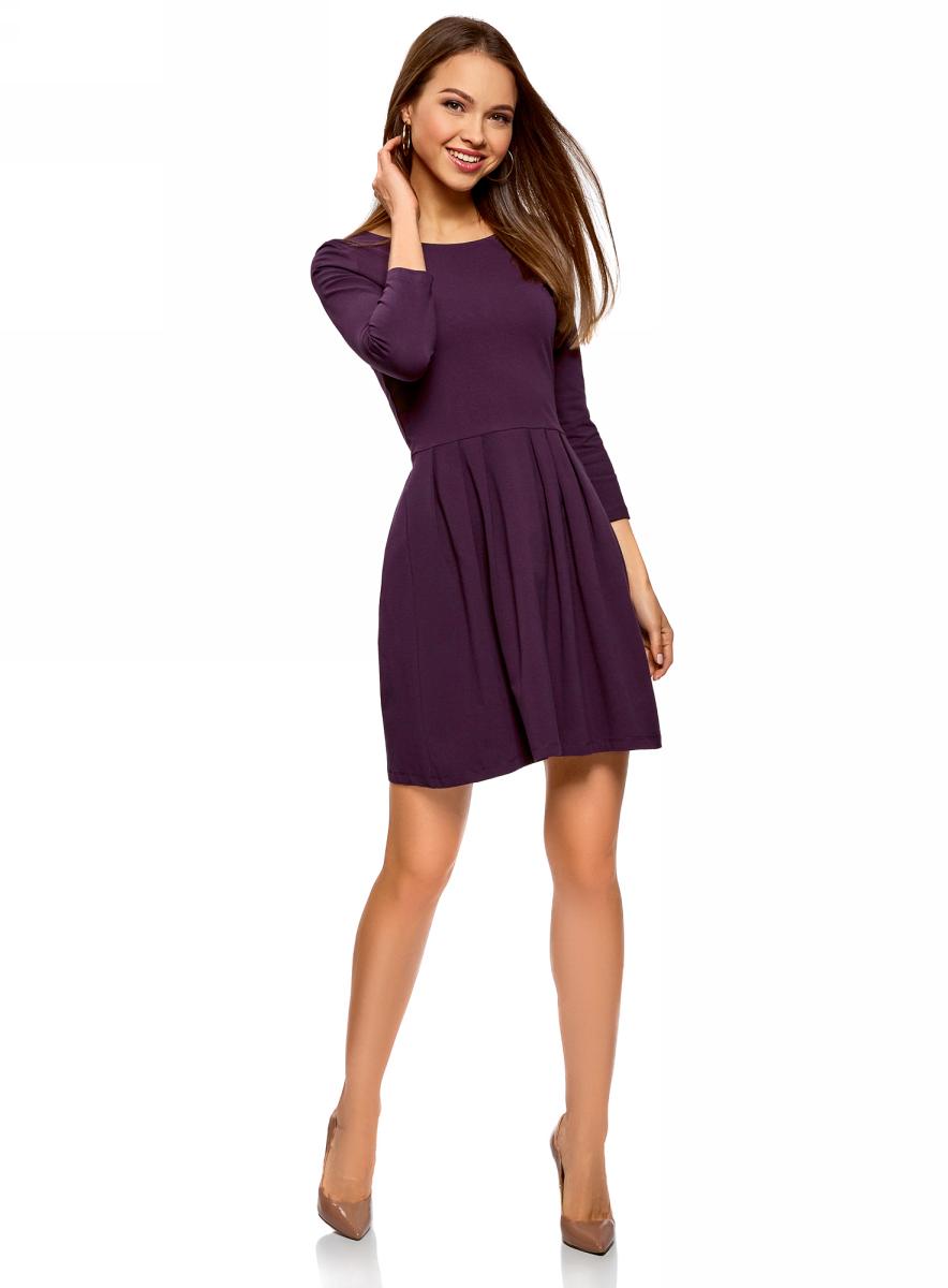 Платье oodji Ultra, цвет: темно-фиолетовый. 14011005-3B/46148/8801N. Размер L (48)14011005-3B/46148/8801NПлатье от oodji выполнено из эластичного хлопкового трикотажа. Модель с рукавами 3/4 и круглым вырезом горловины дополнена отрезной юбкой со складками.