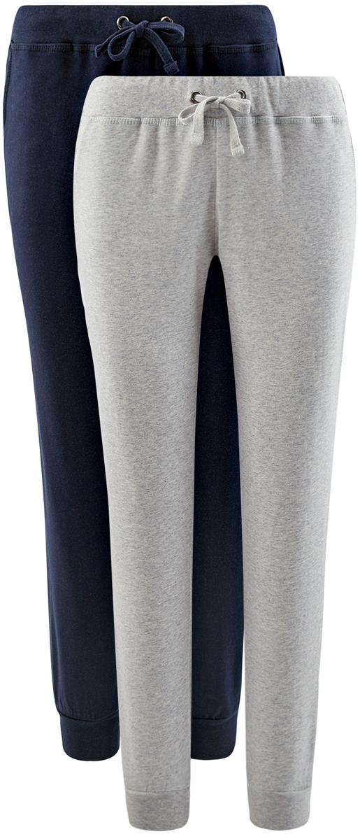 Брюки спортивные женские oodji Ultra, цвет: темно-синий, светло-серый, 2 шт. 16701042T2/46919/19J1N. Размер XXL (52)16701042T2/46919/19J1NСпортивные брюки выполнены из натурального хлопкового трикотажа. Модель с широкой эластичной резинкой на талии дополнена затягивающимся шнурком, по бока имеются втачные карманы. Брючины по низу дополнены широкими трикотажными манжетами.В комплекте 2 пары брюк.