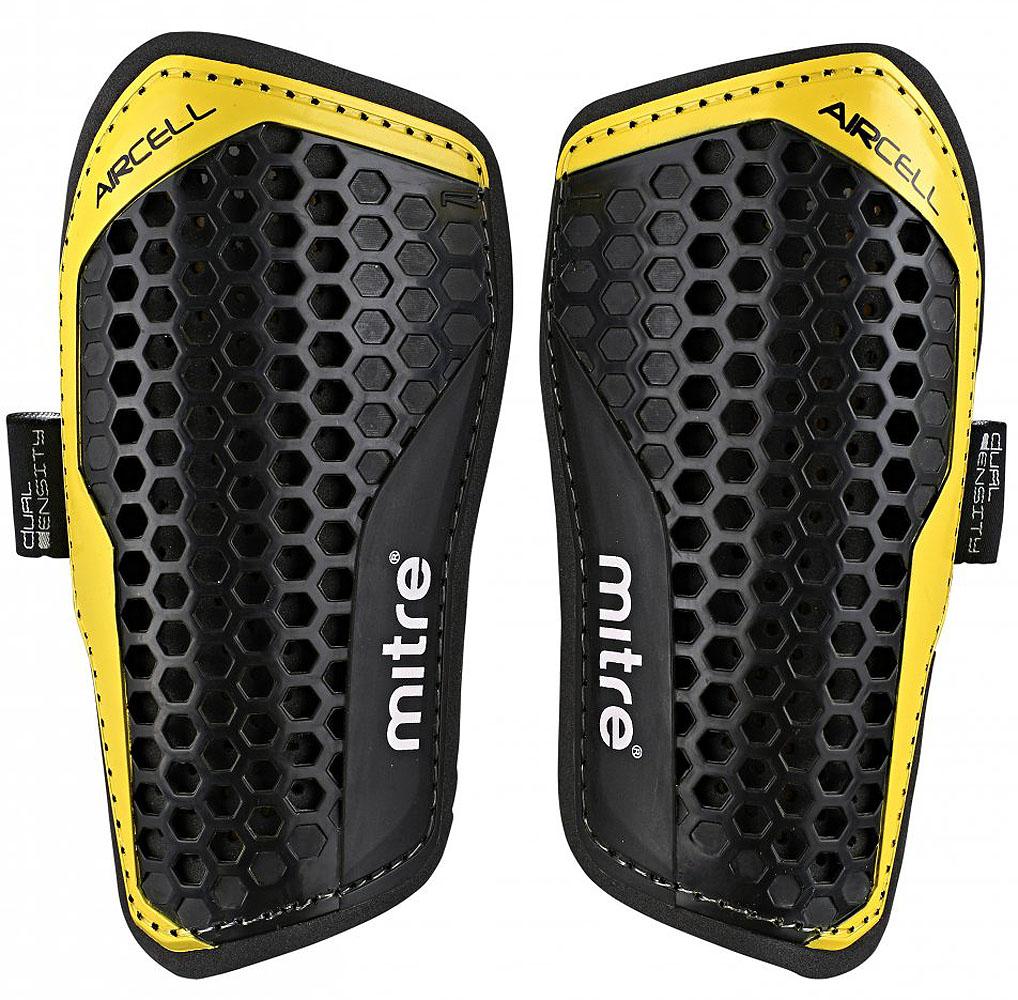 Щитки футбольные Mitre Aircell Carbon Slip, цвет: черный. Размер MS70001BK1Технология Aircell для максимальной вентиляции вашей ноги и комфортной игры. Двойная подкладка поглощает любое воздействие и дает вам большую защиту. Щитки фиксируются специальным бандажом. Рост игрока: 140-160 см.
