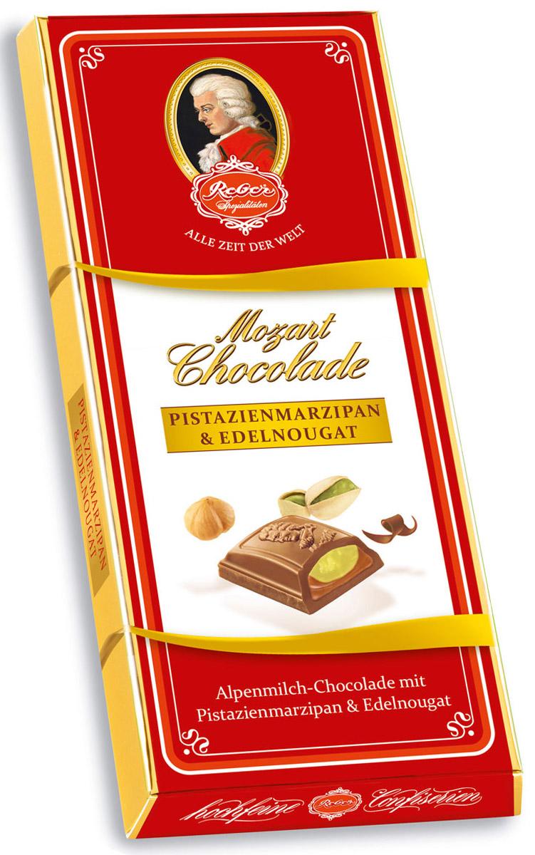 Reber AlpenVollmilch молочный шоколад с ореховым пралине и фисташковым марципаном, 100 г1410133/3Reber AlpenVollmilch - нежный молочный шоколад из альпийского молока с двуслойной начинкой из фисташкового марципанаи сладкой нуги из фундука.Марципан уравновешивает сладость нуги и молочного шоколада, поэтому вкус продукта получается сбалансированный, сдержанный и элегантный.Ракушка сделана из довольно толстого слоя шоколада, поэтому она очень приятно ломается, хрустит и сохраняет собственную форму и вкус.Шоколад из альпийского молока приготовлен по семейному рецепту Reber. Нугуделаютиз средиземноморского медленно обжаренного фундука, сахара, альпийского молока и меда.