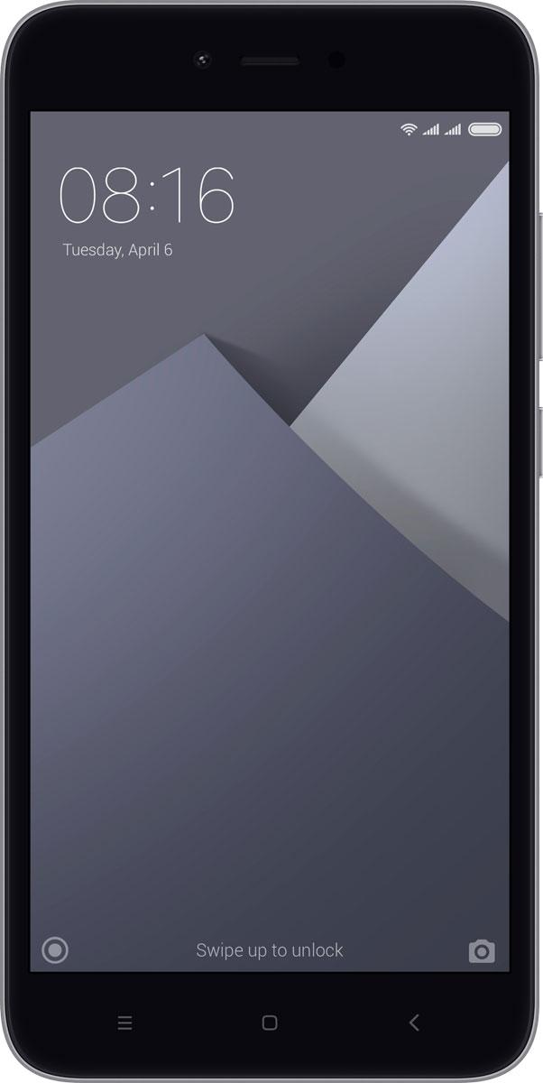 Xiaomi Redmi Note 5A (16GB), GrayREDMINOTE5AGR16GBXiaomi Redmi Note 5A - продолжение популярнейшей линейки мощных и недорогих смартфонов. Он выпускается в полюбившемся многим размере экрана - 5.5 дюйма. Redmi Note опять демонстрирует стремление Xiaomi делать инновации доступными.На большом экране высокой четкости удобно смотреть фильмы, сериалы и играть в ваши любимые игры.При этом его размер удобен для управления одной рукой.Легкий и тонкий. Всего 150 грамм. Напыление, имитирующее металл, позволило сделать корпус легким, а дизайн - футуристическим.Смартфоны с большими экранами могут держать заряд долго. Благодаря емкому аккумулятору (3080 мАч), энергоэффективному процессору и системе оптимизации питания Xiaomi Redmi Note 5A обеспечит до:11 часов просмотра видео;16 часов игры;35 часов активных звонков.Восхитительные селфи. 36 бьюти-фильтров, автоспуск. В Xiaomi это называют - красота в режиме реального времени. Без косметики. Поймайте нужный ракурс, нажмите на кнопку и поделитесь с друзьями!Камера 13 Мп. Невероятное качество снимков. Трудно поверить, что эти фотографии сделаны на камеру смартфона.В Xiaomi Redmi Note 5A вы можете пользовать 2 SIM-картами одновременно с microSD-картой (до 128 ГБ) для хранения фотографий и приложений.Телефон сертифицирован EAC и имеет русифицированный интерфейс меню и Руководство пользователя.