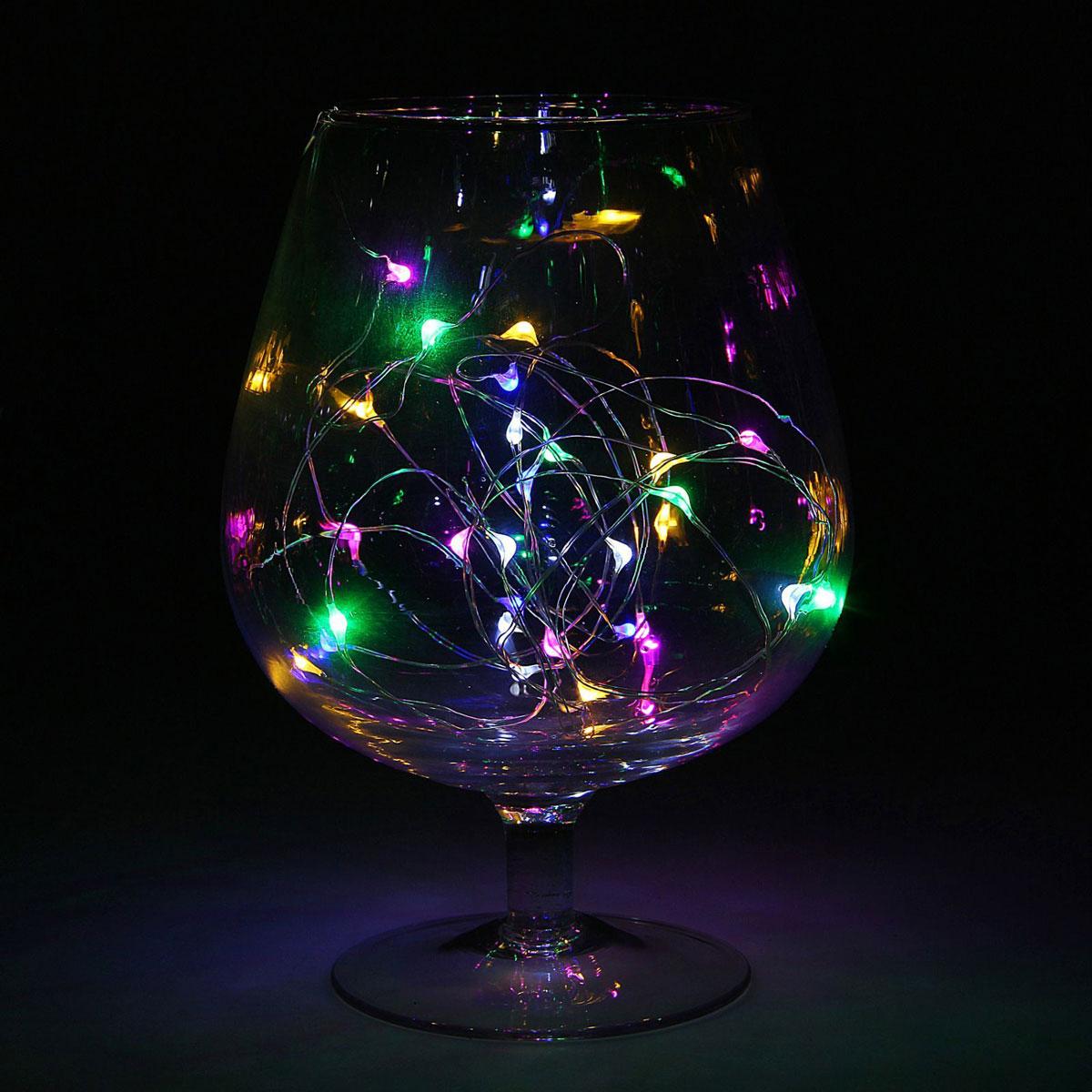 Гирлянда светодиодная Luazon Метраж. Капля росы, цвет: мультиколор, 20 ламп, 2 режима, 3,6 V, длина 2 м. 10805801080580Светодиодные гирлянды и ленты — это отличный вариант для новогоднего оформления интерьера или фасада. С их помощью помещение любого размера можно превратить в праздничный зал, а внешние элементы зданий, украшенные ими, мгновенно станут напоминать очертания сказочного дворца. Такие украшения создают ауру предвкушения чуда. Деревья, фасады, витрины, окна и арки будто специально созданы, чтобы вы украсили их светящимися нитями.