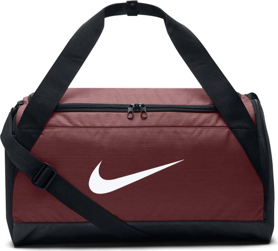 Сумка Nike Brasilia, цвет: бордовый. BA5335-622BA5335-622Сумка-дафл Nike Brasilia (малая) из невероятно прочной ткани позволяет иметь всю нужную экипировку под рукой. Внутренние карманы помогают держать вещи в порядке, а отделение для обуви позволяет хранить влажную экипировку отдельно от сухой.Прочная водонепроницаемая ткань дна защищает экипировку от влаги.Вместительное и универсальное основное отделение.Вентилируемое отделение для хранения влажной/сухой обуви.Водонепроницаемый полиэстер высокой плотности отличается прочностью.Двойные ручки можно соединить вместе для удобного ношения.Мягкая плечевая лямка снимается и регулируется для комфортного ношения.Ручка сбоку как альтернативный вариант ношения.