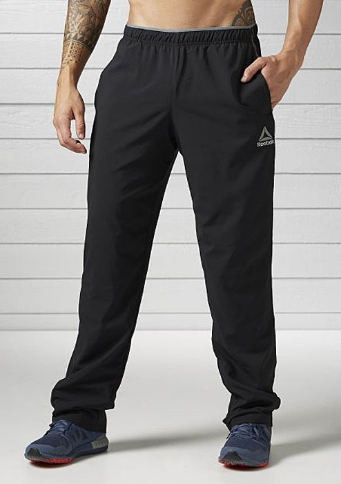Брюки спортивные мужские Reebok Wor Woven Pant, цвет: черный. BK3090. Размер S (44/46)BK3090Спортивные мужские брюки Reebok, выполненные из 100% полиэстера, отлично подходят для тренировок и повседневной носки. Эластичный пояс и внутренний шнурок, обеспечат оптимальную посадку. Модель дополнена двумя прорезными карманами.
