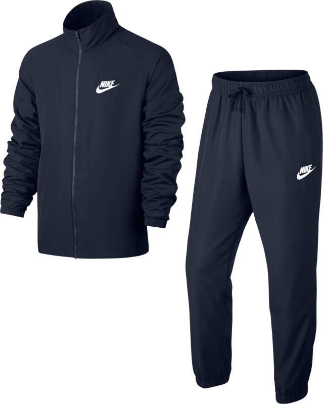 Спортивный костюм мужской Nike M Nsw Trk Suit Wvn Basic, цвет: темно-синий. 861778-451. Размер S (44/46)861778-451Мужской спортивный костюм Nike Sportswear, состоящий из олимпийки и брюк, выполнен из гладкого тканого материала с классическим силуэтом, анатомическим кроем рукавов и идеальной посадкой - удобная базовая модель. Гладкий и легкий тканый материал.
