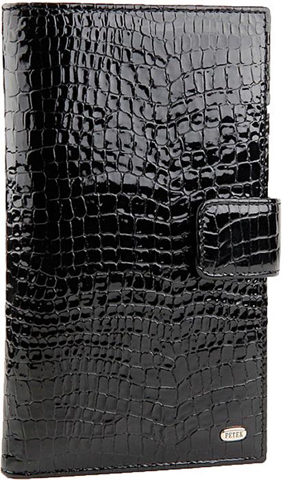 Бумажник мужской Petek 1855, цвет: черный. 2394.091.012394.091.01 BlackСовременное удобное мужское портмоне Petek из натуральной кожи черного цвета с гладкой фактурой. Внутри имеются четыре кармана для купюр, отделение на молнии, 17 карманов для кредитных карт