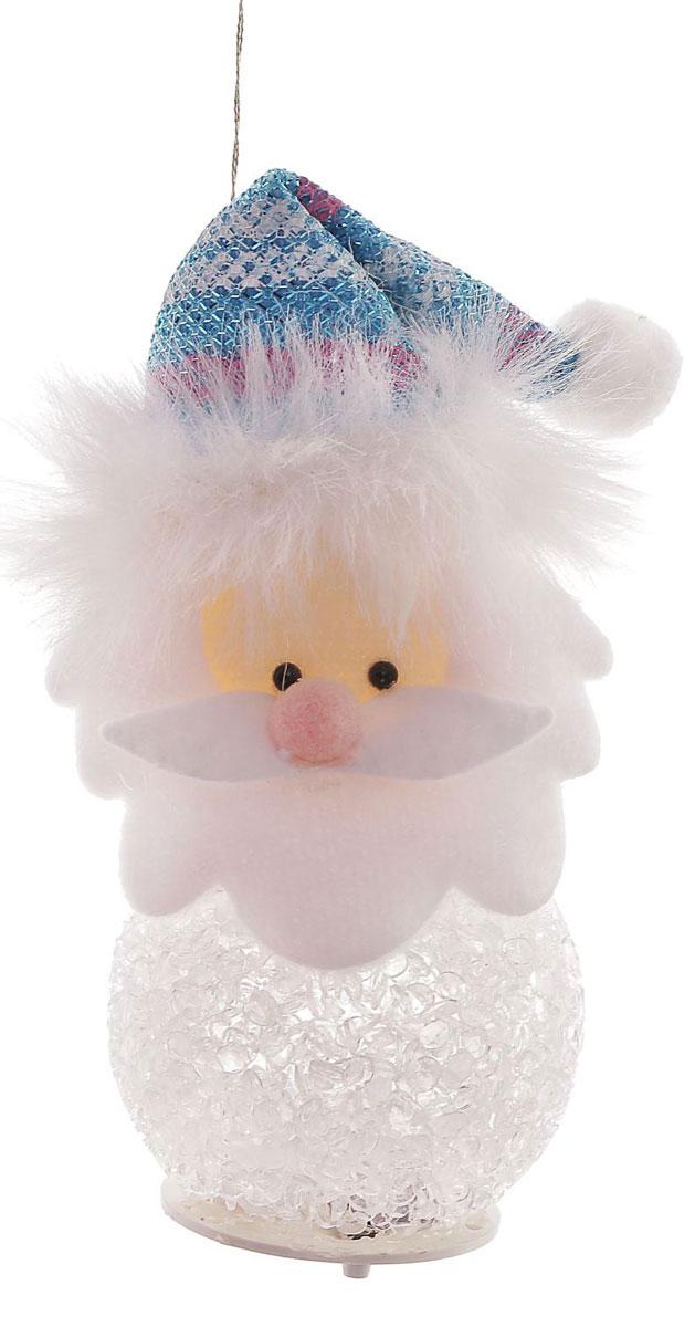 Новогоднее подвесное украшение Дед Мороз в голубом колпаке, с подсветкой1102734Новогоднее украшение ручной работы отлично подойдет для декорации вашего дома и новогодней ели. С помощью специальной петельки украшение можно повесить в любом понравившемся вам месте. Но, конечно, удачнее всего оно будет смотреться на праздничной елке.Елочная игрушка - символ Нового года. Она несет в себе волшебство и красоту праздника. Такое украшение создаст в вашем доме атмосферу праздника, веселья и радости.