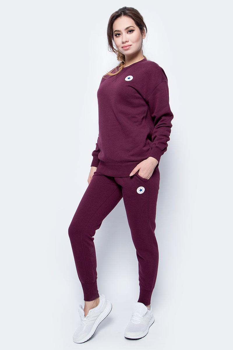 Брюки спортивные женские Converse Core Signature Pant, цвет: бордовый. 10004546262. Размер XL (50)10004546262Женские спортивные брюки изготовлены из качественного трикотажа на основе хлопка. Модель на широкой эластичной резинке и шнурке на талии дополнена боковыми карманами. Брючины снизу оформлены широкими резинками. Такие брюки незаменимая вещь в спортивном и летнем гардеробе. Прекрасный выбор для занятий фитнесом или активного отдыха.