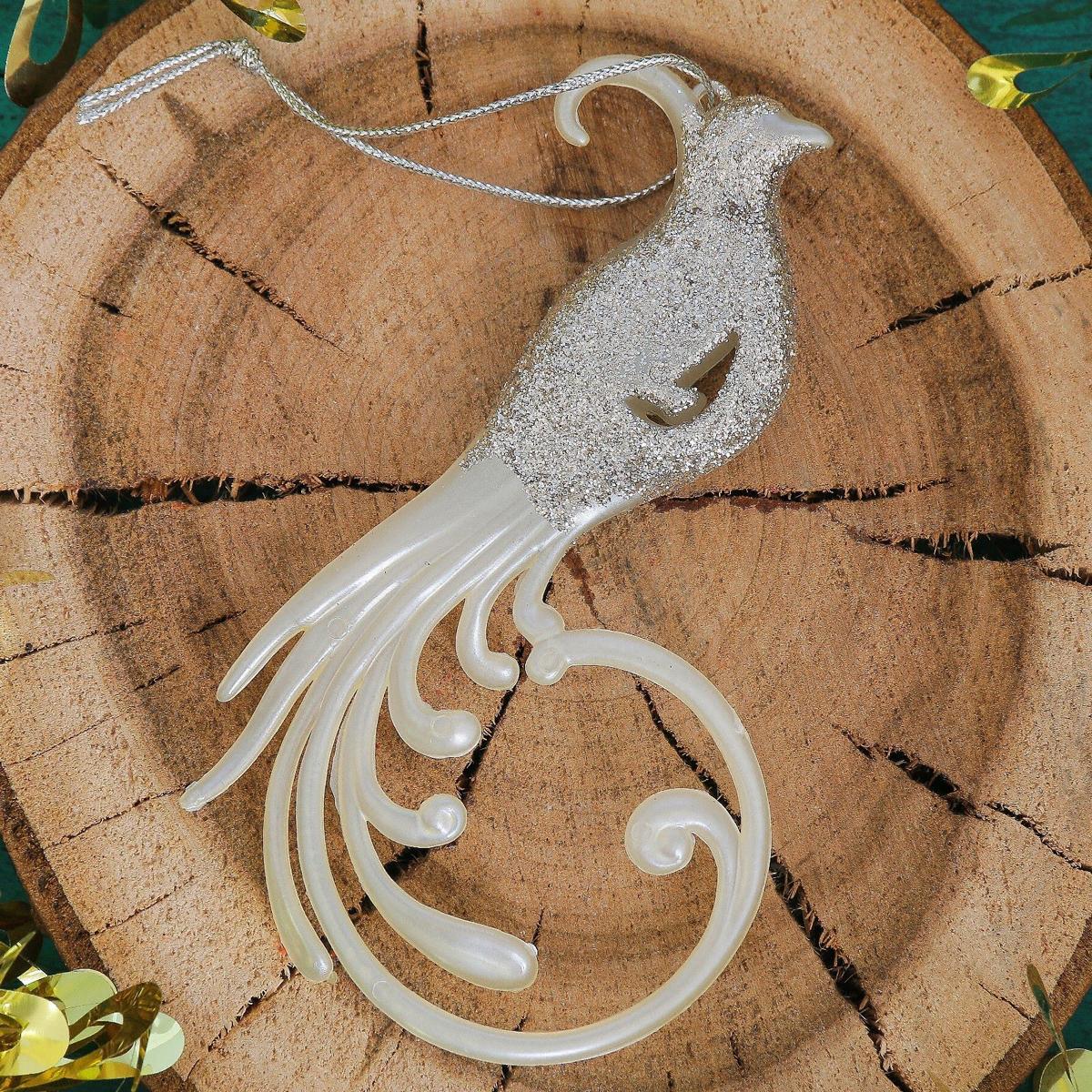 Новогоднее подвесное украшение Райская птица, 8 х 14 см2371446Новогоднее подвесное украшение отлично подойдет для декорации вашего дома и новогодней ели. С помощью специальной петельки украшение можно повесить в любом понравившемся вам месте. Но, конечно, удачнее всего оно будет смотреться на праздничной елке.Елочная игрушка - символ Нового года. Она несет в себе волшебство и красоту праздника. Такое украшение создаст в вашем доме атмосферу праздника, веселья и радости.