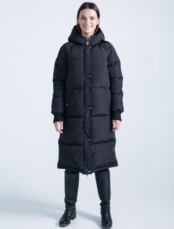 Пальто женское Defreeze, цвет: черный. 72-202_black. Размер 4272-202_blackМодное пальто DEFREEZE выполнено из полиэстера с крупной стежкой. В качестве утеплителя используется био-пух, выдерживающий значительные морозы. Модель имеет длину ниже колена, объемный силуэт и свободный крой, что очень модно в этом сезоне. Модель застегивается на молнию, которая дополнена ветрозащитной планкой на кнопках. Пальто имеет рукава-реглан с вязаными манжетами, цельнокроеный капюшон и два кармана на кнопках.