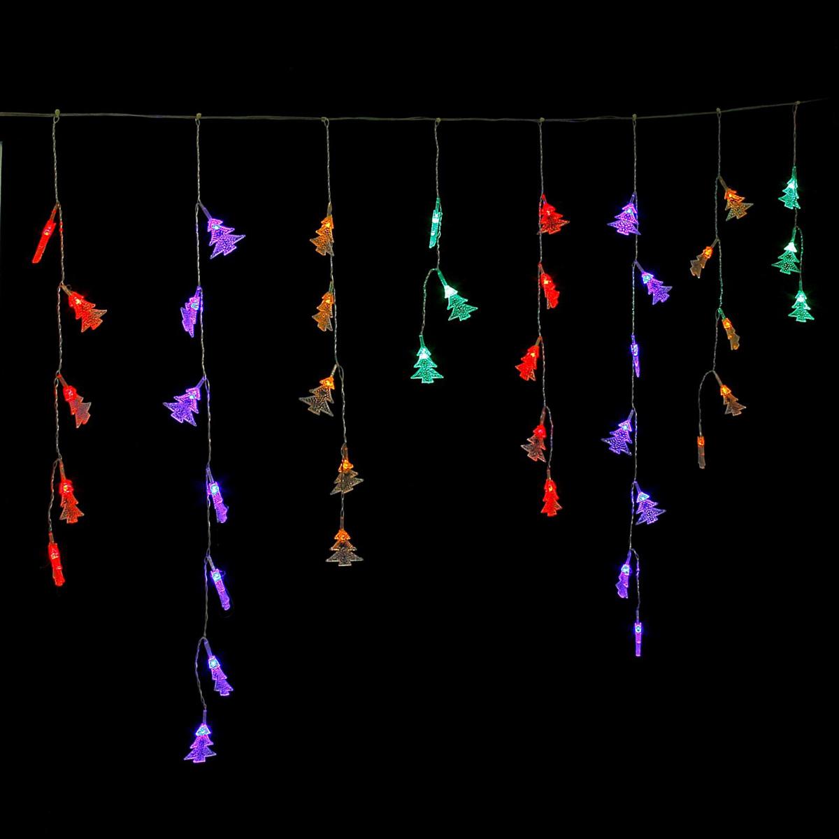 Гирлянда светодиодная Luazon Бахрома. Елки, 48 ламп, 220 V, цвет: мультиколор, 1,4 х 0,3 м. 671650671650Светодиодные гирлянды, ленты и т.д — это отличный вариант для новогоднего оформления интерьера или фасада. С их помощью помещение любого размера можно превратить в праздничный зал, а внешние элементы зданий, украшенные ими, мгновенно станут напоминать очертания сказочного дворца. Такие украшения создают ауру предвкушения чуда. Деревья, фасады, витрины, окна и арки будто специально созданы, чтобы вы украсили их светящимися нитями.