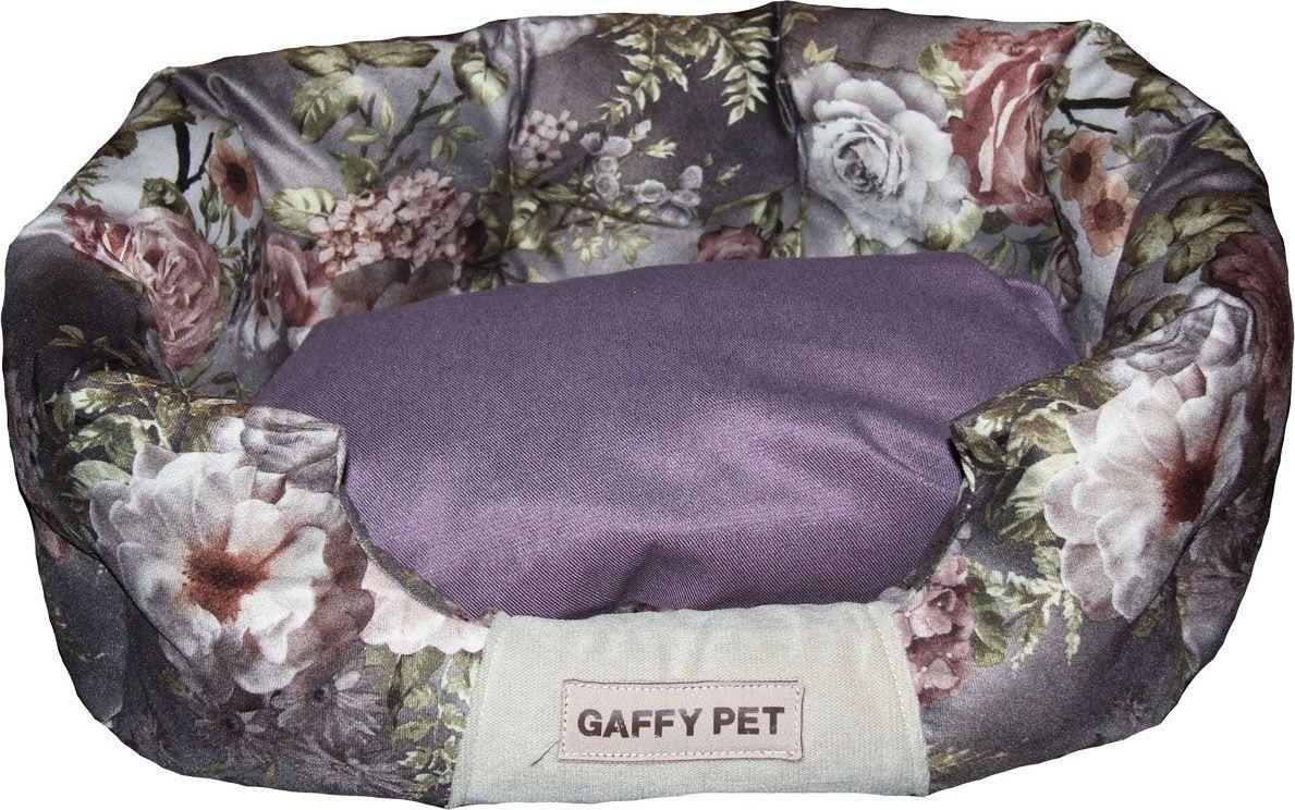 Лежак для животных Gaffy Pet One Pion, цвет: фиолетовый, 65 х 40 х 26 см11204MЛежак для животных Gaffy Pet обязательно понравится вашему питомцу. Верх лежака выполнен из плотного текстиля. В качестве наполнителя используется мягкий холлофайбер. Изделие имеет высокие бортики, которые отлично держат форму. Использование профессиональных тканей дает владельцам питомцев большое преимущество в чистке и уходе без ущерба внешнему виду. Такой лежак прекрасно впишется в любой современный интерьер.