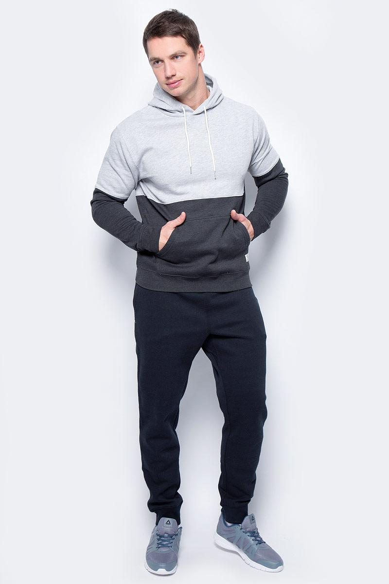 Худи мужское DC Shoes, цвет: светло-серый, черный. EDYFT03270-KNFH. Размер XL (52/54)EDYFT03270-KNFHМужское худи DC Shoes выполнено из мягкого теплого флиса с начесом. Модель имеет декоративный панельный крой, длинные стандартные рукава и капюшон со шнурком для регулировки объема. Манжеты рукавов, горловина и низ изделия дополнены эластичным материалом в рубчик. Спереди расположен карман-кенгуру.