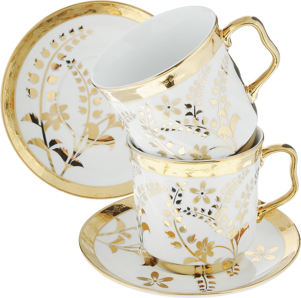 Сервиз чайный Bohmann, цвет: белый, золотой, 4 предмета1861ВНР_вид 2Чайный сервиз Bohmann станет незаменимым элементом среди коллекции вашей посуды. Ежедневное чаепитие в компании семьи или друзей ни с чем не сравнить. И тут не обойтись без красивой посуды, из которой приятно выпить ароматного чаю. Посуда выполнена из качественного белого фарфора, украшенного изящным узором. Изысканный дизайн чайной пары впишется как в торжественное, так и в повседневное оформление стола. В наборе две чашки объемом по 350 мл и два блюдца диаметром по 15,5 см. Фарфор не вступает в реакцию с напитком, поэтому никак не влияет на его вкус. Материал способен длительное время удерживать тепло, что позволяет растянуть удовольствие от чаепития. Диаметр блюдца: 15 см.Диаметр чашки: 9 см.Высота чашки: 9 см.