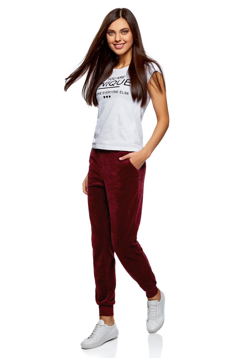 Брюки спортивные женские oodji Ultra, цвет: бордовый. 16701052B/47883/4900N. Размер XXS (40)16701052B/47883/4900NЖенские спортивные брюки oodji изготовлены из качественной смесовой ткани. Модель выполнена с широким эластичным поясом и завязками на талии. Низы брючин дополнены широкими манжетами.