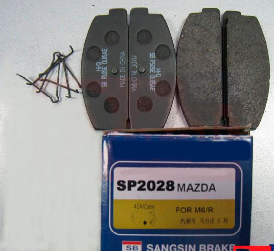 Тормозные колодки дисковые Sangsin SP2028SP2028Колодки тормозные задние дисковые MAZDA 323, 626, Sangsin. SP2028