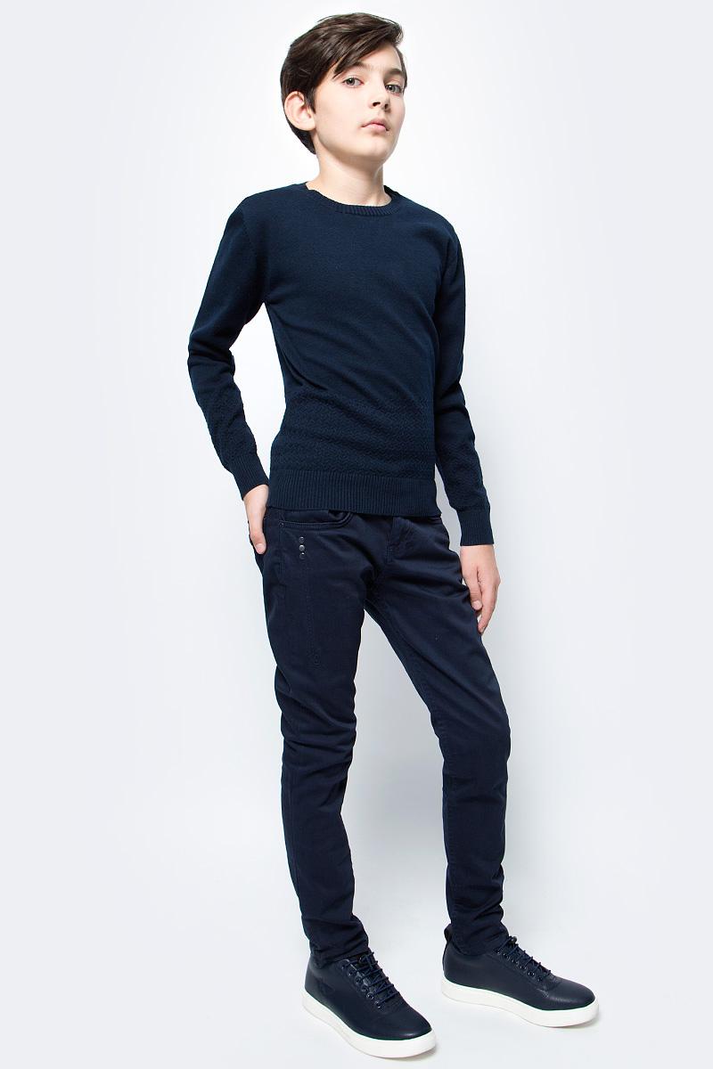 Джемпер для мальчика Vitacci, цвет: темно-синий. 1173004-04. Размер 1641173004-04Джемпер школьный для мальчика выполнен из натурального хлопка. Модель с круглым вырезом горловины и длинными рукавами.