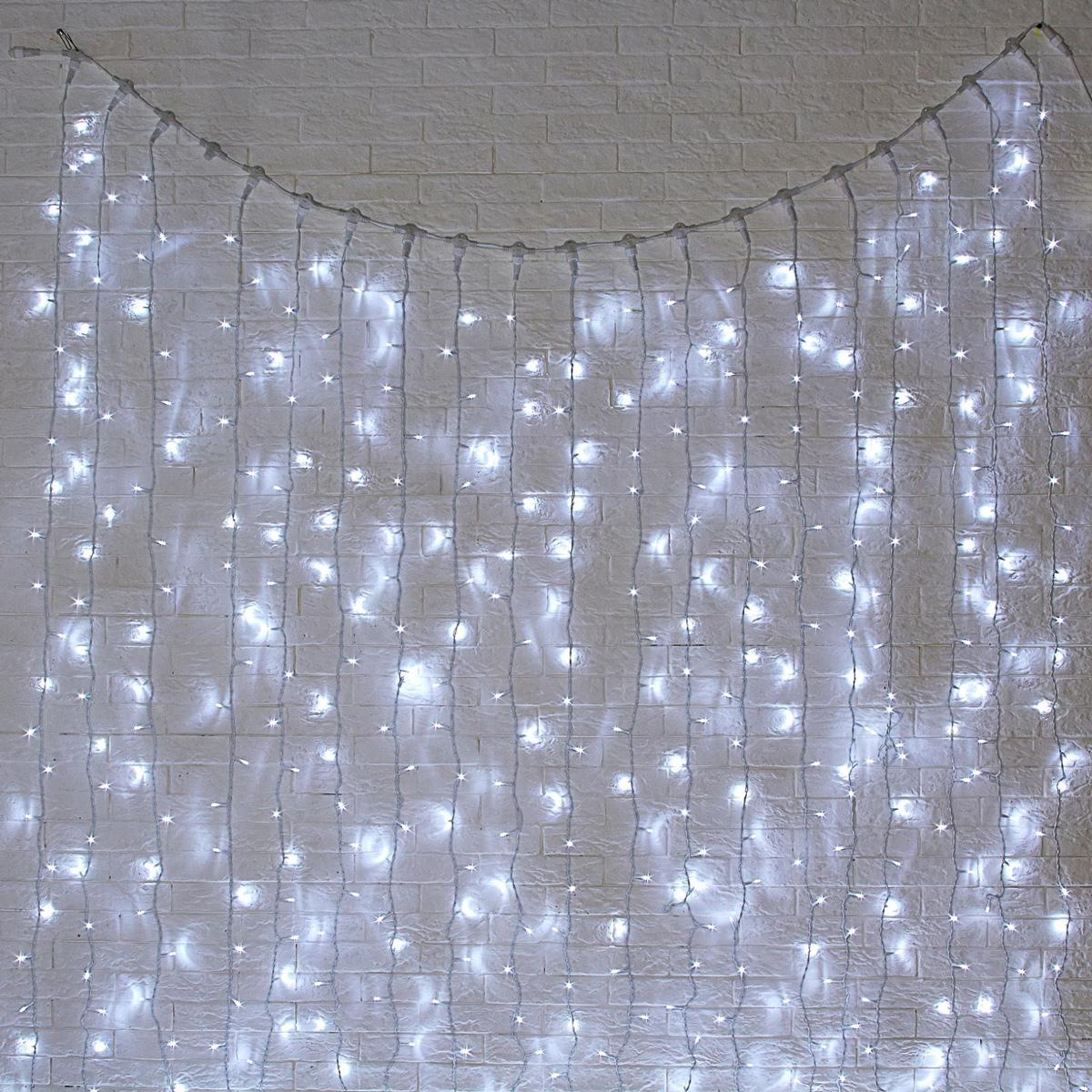 Гирлянда светодиодная Luazon Занавес, цвет: белый, уличная, 1440 ламп, 220 V, 2 х 6 м. 10802561080256Гирлянда светодиодная Luazon Занавес - это отличный вариант для новогоднего оформления интерьера или фасада. С ее помощью помещение любого размера можно превратить в праздничный зал, а внешние элементы зданий, украшенные гирляндой, мгновенно станут напоминать очертания сказочного дворца. Такое украшение создаст ауру предвкушения чуда. Деревья, фасады, витрины, окна и арки будто специально созданы, чтобы вы украсили их светящимися нитями.