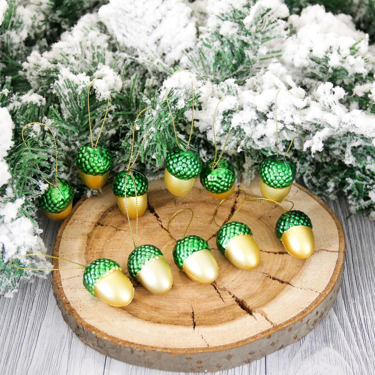 Набор новогодних подвесных украшений Желуди, высота 3,5 см, 24 шт2155344Набор новогодних подвесных украшений отлично подойдет для декорации вашего дома и новогодней ели. С помощью специальной петельки украшение можно повесить в любом понравившемся вам месте. Но, конечно, удачнее всего оно будет смотреться на праздничной елке.Елочная игрушка - символ Нового года. Она несет в себе волшебство и красоту праздника. Такое украшение создаст в вашем доме атмосферу праздника, веселья и радости.