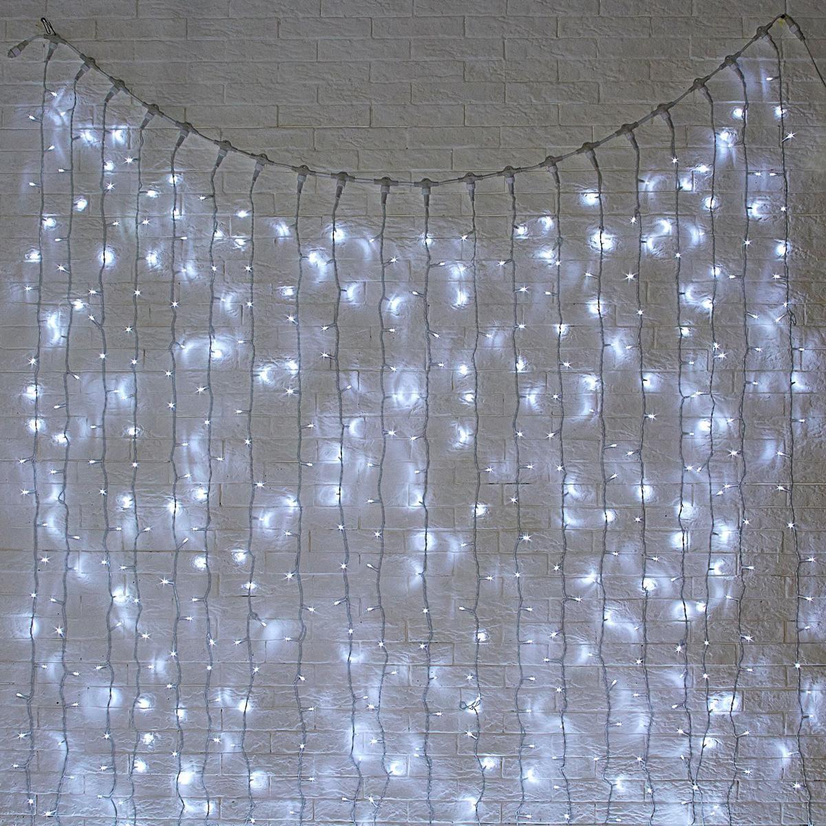 Гирлянда светодиодная Luazon Занавес, цвет: белый, уличная, 1800 ламп, 220 V, 2 х 9 м. 10803021080302Светодиодные гирлянды и ленты — это отличный вариант для новогоднего оформления интерьера или фасада. С их помощью помещение любого размера можно превратить в праздничный зал, а внешние элементы зданий, украшенные ими, мгновенно станут напоминать очертания сказочного дворца. Такие украшения создают ауру предвкушения чуда. Деревья, фасады, витрины, окна и арки будто специально созданы, чтобы вы украсили их светящимися нитями.